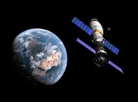 A manned Soyuz TMA-M spacecraft docked with an extended stay module Fine-Art Print