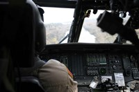 A UH-60 Blackhawk flies the River to an Unknown Village to Drop off a Care Package Fine-Art Print