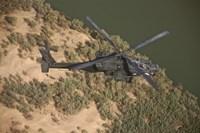 An AH-64D Apache Helicopter in Flight Fine-Art Print