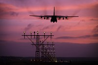 A C-130J Super Hercules landing at Ramstein Air Base, Germany Fine-Art Print