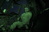 A Pilot Wears Night vision Goggles in the Cockpit of a CH-47 Chinook Helicopter Fine-Art Print