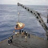 The Apollo Spacecraft Command Module is Recovered Aboard USS Bennington Fine-Art Print