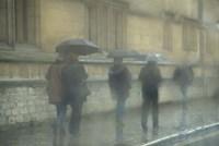 Walking in the rain, Oxford University, England Fine-Art Print