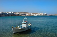 Mykonos, Greece Boat off the island with view of the city behind Fine-Art Print