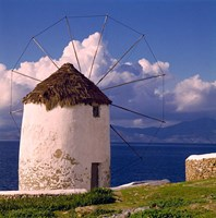 Greece, Mykonos, Windmill looks over Azure Sea Fine-Art Print
