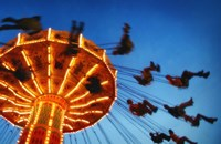Adults Riding a Carnival Swing Game Fine-Art Print