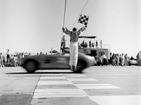 Man Jumping Waving Checkered Flag Fine-Art Print