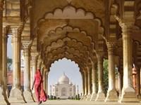 Woman in traditional Sari walking towards Taj Mahal Fine-Art Print