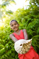 Village boy with large sea shell, Beqa Island, Fiji Fine-Art Print
