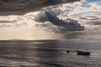 Dramatic light over a little boat, Mamanucas Islands, Fiji, South Pacific Fine-Art Print
