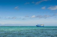 Fishing boat in the turquoise waters of the blue lagoon, Yasawa, Fiji, South Pacific Fine-Art Print