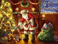 Santa putting gifts under tree Fine-Art Print