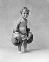 1930s Baby Boy Toddler Wearing  Boxing Gloves Fine-Art Print