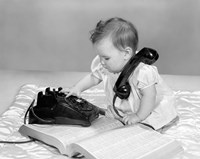 1960s Baby Girl With Telephone Book Fine-Art Print