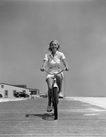 1940s Summer Time Smiling Woman Riding Bike On Beach Boardwalk Fine-Art Print