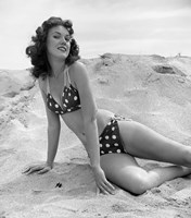 1950s 1960s Brunette Bathing  Stretched Out On Sand? Fine-Art Print