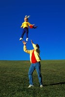 1990S Father Tossing Daughter Up In The Air Fine-Art Print