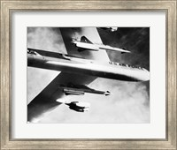 Low angle view of a bomber plane carrying missiles during fight, AGM-28 Hound Dog, B-52 Stratofortress Fine-Art Print