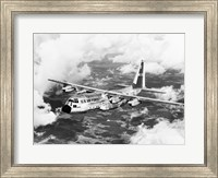 High angle view of a military airplane in flight, C-130 Hercules Fine-Art Print