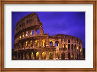 Low angle view of a coliseum lit up at night, Colosseum, Rome, Italy Fine-Art Print