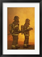 Rear view of two firefighters extinguishing a fire Fine-Art Print