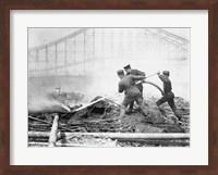 Three firefighters extinguishing a fire Fine-Art Print
