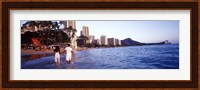 Rear view of a couple wading on the beach, Waikiki Beach, Honolulu, Oahu, Hawaii, USA Fine-Art Print