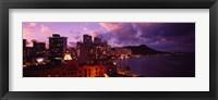 Buildings lit up at dusk, Waikiki, Oahu, Hawaii, USA Fine-Art Print