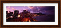 Buildings lit up at dusk, Waikiki, Oahu, Hawaii, USA Fine-Art Print