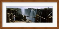 Woman looking at the Victoria Falls from a viewing point, Zambia Fine-Art Print