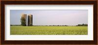 USA, Arkansas, View of grain silos in a field Fine-Art Print