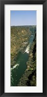 Kayakers paddle down the Zambezi gorge away from the Victoria Falls, Zambia Fine-Art Print