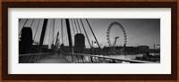 Bridge across a river with a ferris wheel, Golden Jubilee Bridge, Thames River, Millennium Wheel, London, England Fine-Art Print