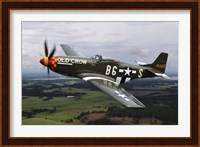 A North American P-51 Mustang in flight over Vasteras, Sweden Fine-Art Print