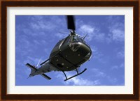 Former US Air Force Bell UH-1E Huey helicopter in flight Fine-Art Print