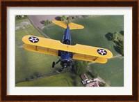 Boeing Stearman Model 75 Kaydet flying over fields Fine-Art Print