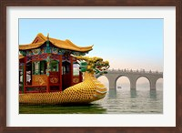 The Summer Palace, a traditional Dragon Boat passes the Seventeen Arch Bridge, Kunming lake, Beijing, China Fine-Art Print