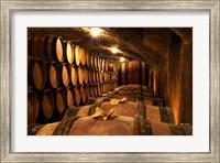 Wooden Barrels with Aging Wine in Cellar Fine-Art Print